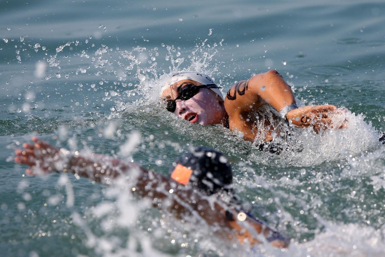 Poliano Okimoto. Copa do Mundo de Maratonas Aquaticas, etapa Travessia de Hong Kong na Repulse Bay . 18 de Outubro de 2014, Hong Kong. Foto: Satiro Sodre/SSPress.