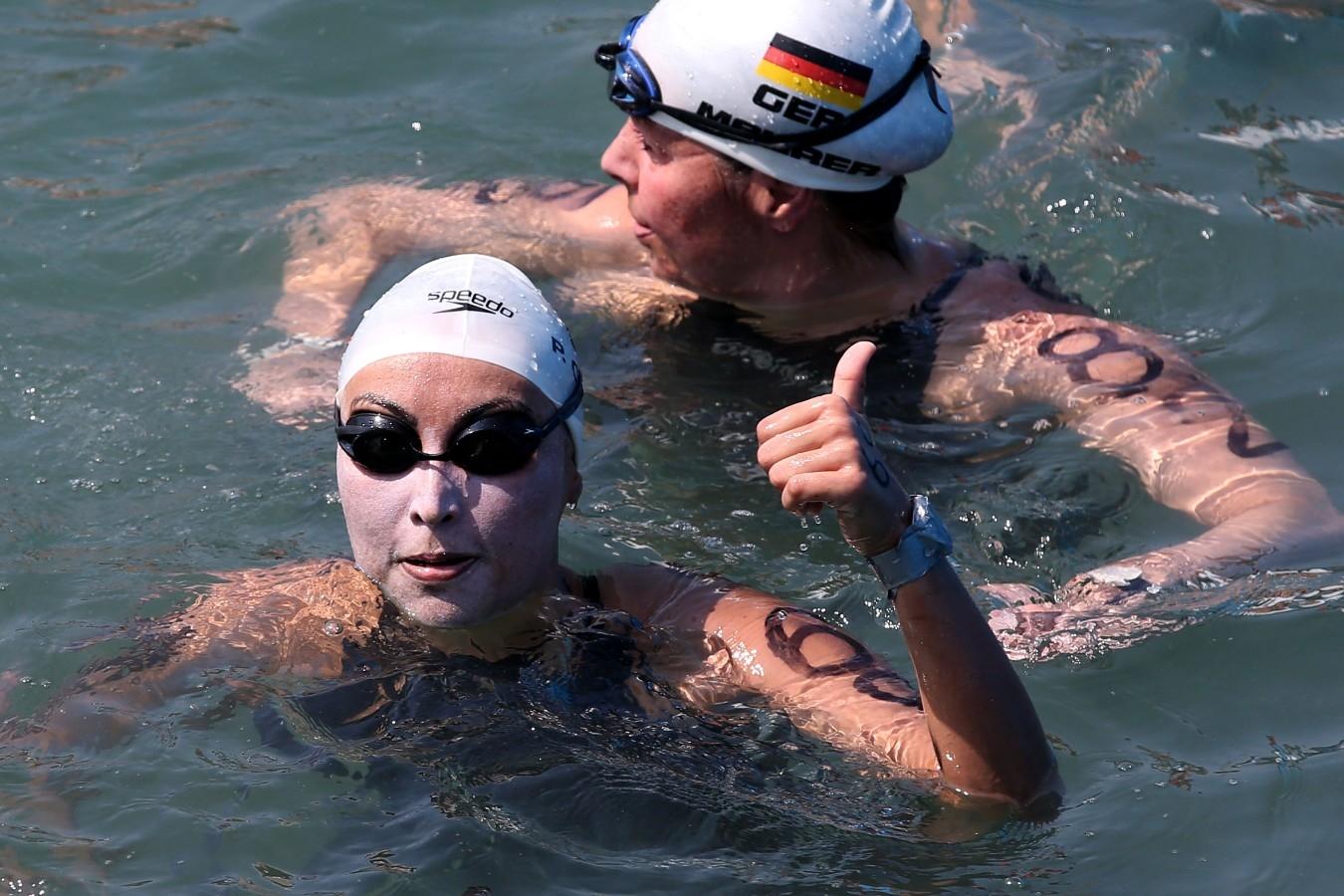 Poliana Okimoto. Copa do Mundo de Maratonas Aquaticas, etapa Travessia de Hong Kong na Repulse Bay . 18 de Outubro de 2014, Hong Kong. Foto: Satiro Sodre/SSPress.